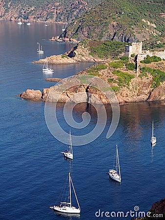 Free Sailboat And Girolata Genovese Fort Royalty Free Stock Photo - 27388565