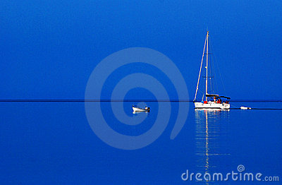 Sailboat on blue water