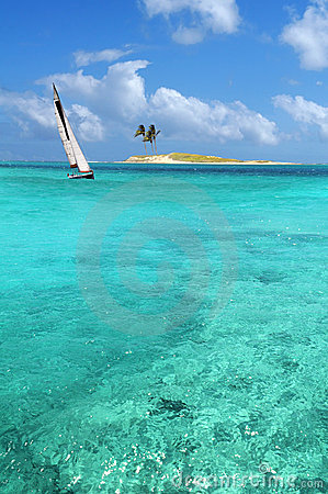 Sailboat In Crystal Clear Waters