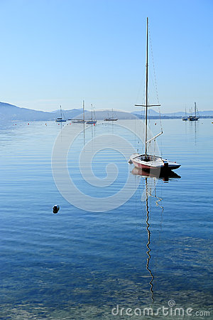 Sailboat on glassy water