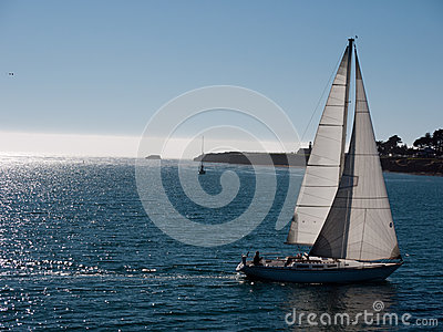 Sailboat gliding on calm sea