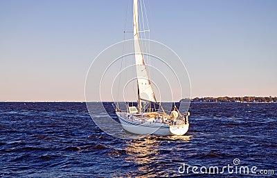 Sailboat heading to sea
