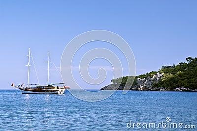 A sailboat near rocky coast