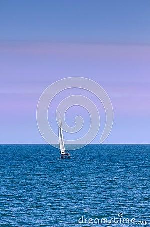 Sailboat On Ocean at Dusk