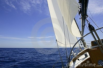 Sailboat sailing blue sea on sunny summer day