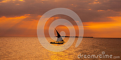 Sailboat sailing in the sunset