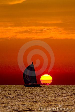 Sailboat in the sunset.