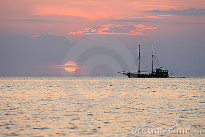 Sailboat during sunset above the sea