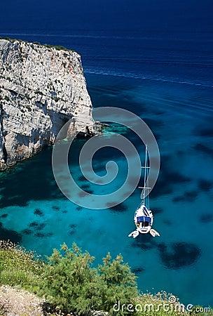 Sailboat in turquoise lagoon