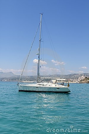 Sailboat turquoise tropical Moraira Playa Portet