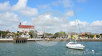 Sailboat and waterfront buildings