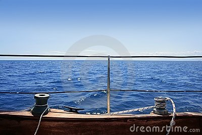Sailboat winches wooden board blue sea horizon
