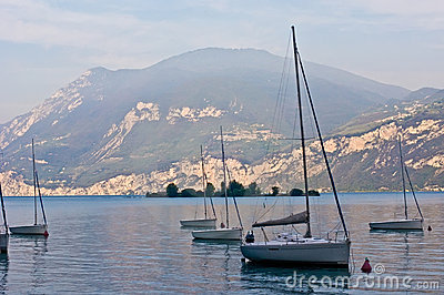 Sailboats on dawn, lake Garda