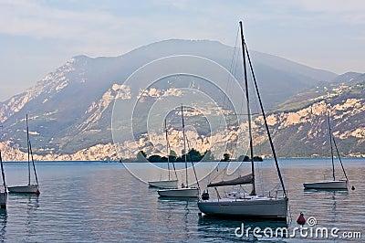 Sailboats on dawn, lake Garda