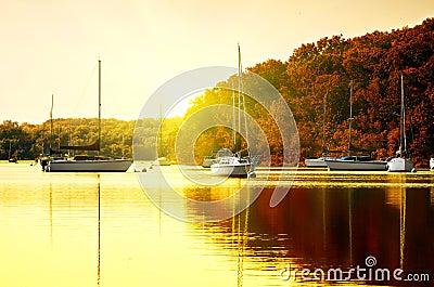 Sailboats on lake at sunset