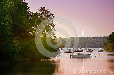 Sailboats on lake at sunset
