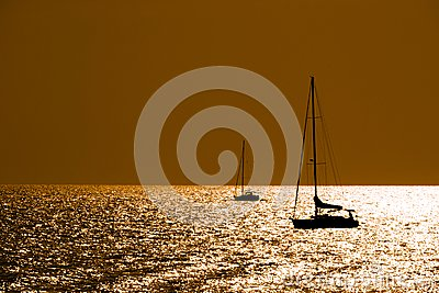 Sailboats silhouettes at dusk