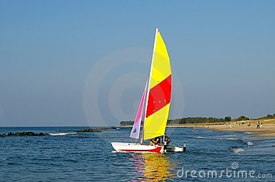 Sailing boat at beach.