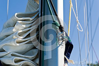 Sailing boat mast with mainsail and spinnaker