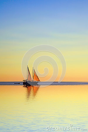 Free Sailing Boat On A Tropical Ocean At Twilight Royalty Free Stock Photo - 29146275