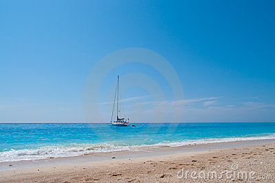 Sailing Boat and Sandy Beach
