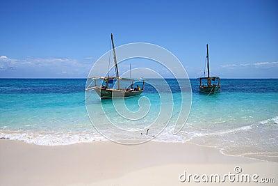 Sailing boats in ocean beach