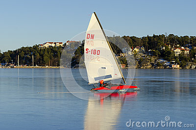 Sailing DN iceboat at high speed Editorial Stock Photo