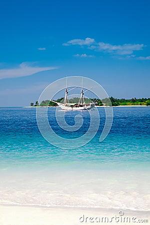 Sailing ship and tropical island