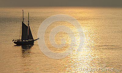 Sailing during a sunset.
