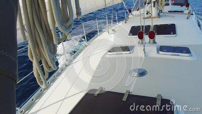 Sailing yacht boat driving thru the ocean on a sunny day stock footage