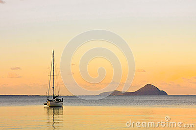 Sailing yacht on calm sea at sunset