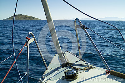 Sailing yacht going to an isolated island