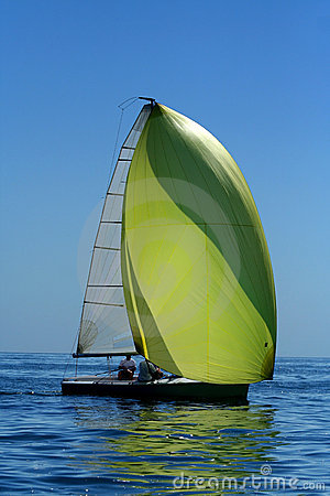 Sailing yacht with spinnaker in the wind
