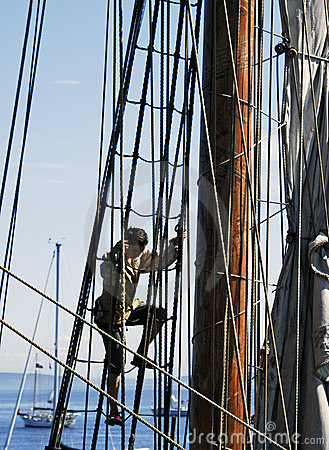 Sailor climbing ship rigging