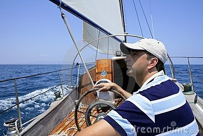Sailor sailing in the sea. Sailboat over blue