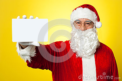 Saint Nick flashing a blank placard to the camera