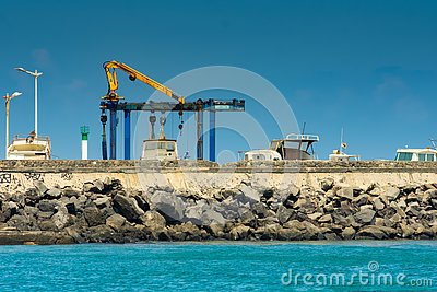 Saint-Pierre, France - September 27 2018: Sunny blue sky profile of harbor in Saint-Pierre Reunion Island Editorial Stock Photo