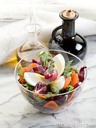 Salad with arugula carrot and egg