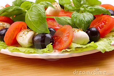 Salad with basil, mozzarella, olives and tomato
