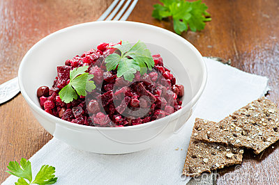 Salad with beetroot, potatoes, pickled cucumber and green peas
