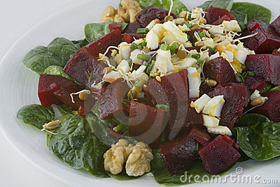 Salad with beets, boiled egg, and bean sprouts