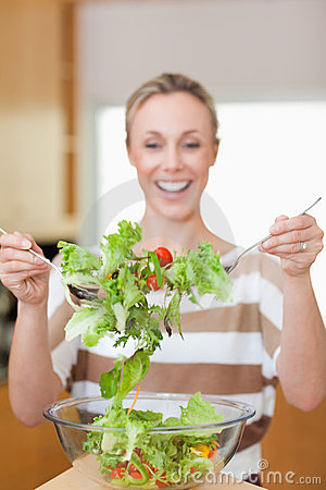 Salad being stirred by woman