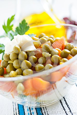 Salad with boiled carrots and canned green peas