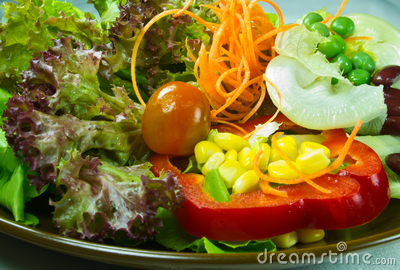 Salad on brown plate