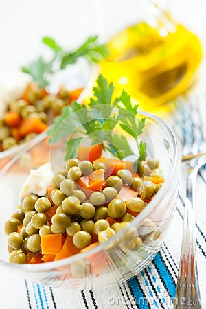 Salad with canned green peas and boiled vegetables