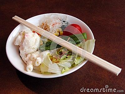 Salad and chopsticks