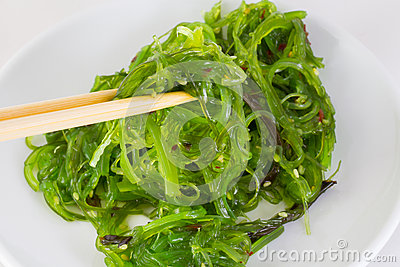 Salad chuka in white dish with chopsticks