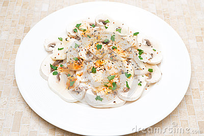 Salad of fresh mushrooms with red pepper, olive oil, herbs