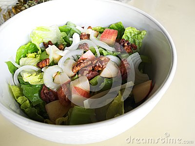 Salad greens with apple, walnuts
