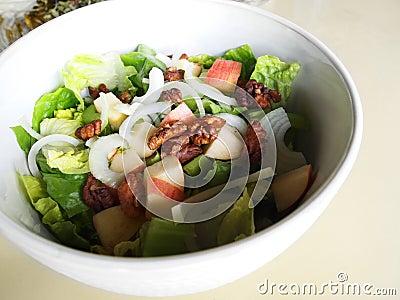 Salad greens with apple, walnuts
